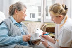 caregiver checking a senior woman